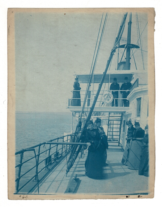 Cyanotype of Amherst H. Wilder with his wife and daughter. Edward A. Bromley, photographer.